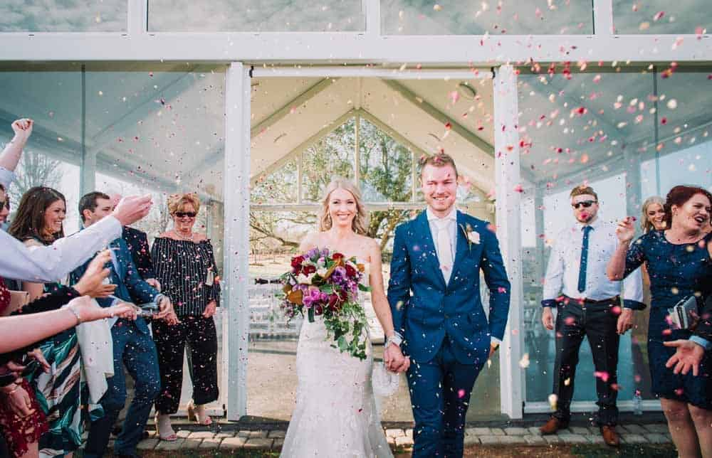 Brisbane Wedding - throwing petals after wedding ceremony